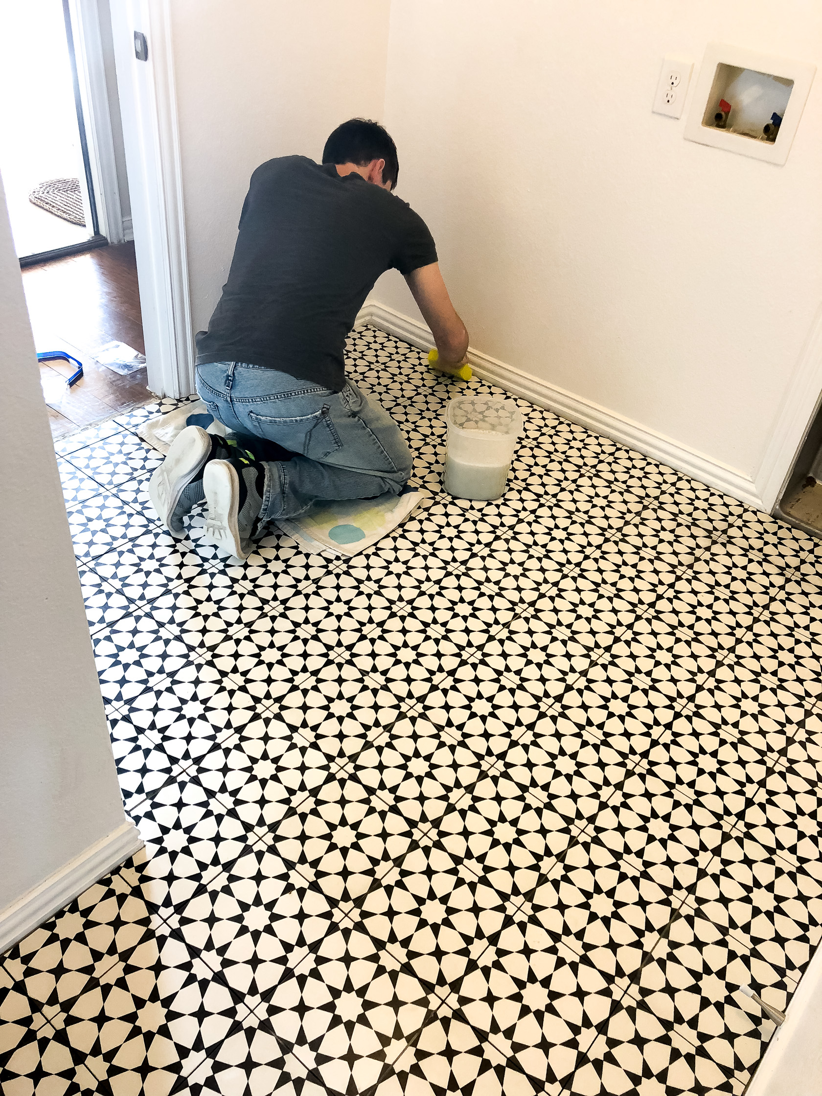 Home tour laundry bath makeover hello ivory rose we decided to buy a dark charcoal grout and aaron spent the day grouting the tile after consulting youtube to finish the job and it turned out fantastic dailygadgetfo Gallery